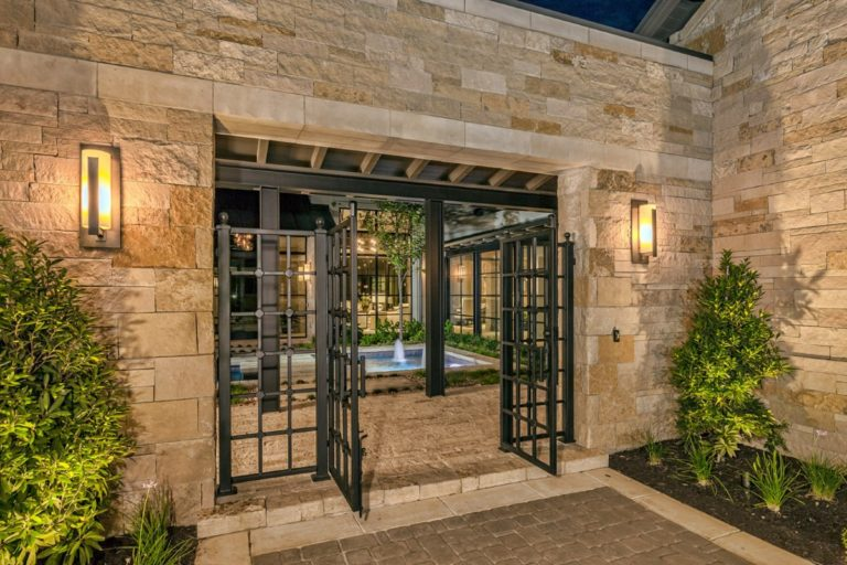 iron gates opening up to a backyard