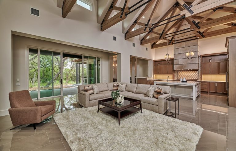 large living room with wooden ceiling beams