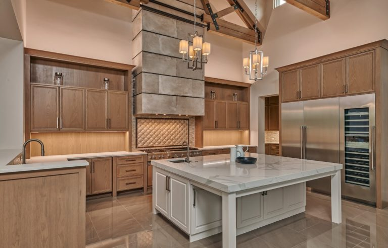 gray and tan colored large gourmet kitchen